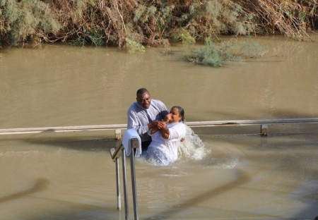 Baptism in the Jordan River. Photo by Leon Mauldin.