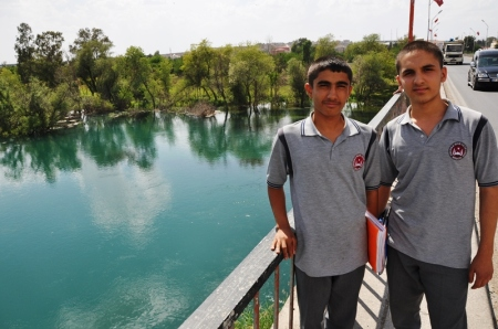 High school boys at Belcik, Turkey, on bridge crossing Euphrates. Photo by Leon Mauldin.